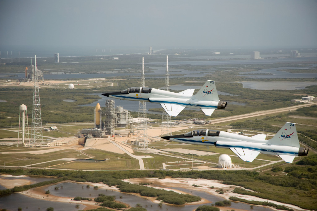 "Photographs of NASA aircraft (T-38 and STA) over duel space shuttles on pads A (STS-125) & B (STS-400/STS-127) at KSC. Pilots: NASA 962 (Jack ""Triple"" Nickel); NASA 901 (Scott Reagan); NASA 924 (Charlie Justiz); STA (Ken Baker). Photo Date: April 17, 2009. Location: KSC - Pads A&B. Photographer: Robert Markowitz"